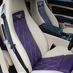 designls ltd custom leather vehicle interior seats upholstered in bentley autonappa leather diamond quilted seat centres in purple with magnolia coloured leather side bolsters bentley logos